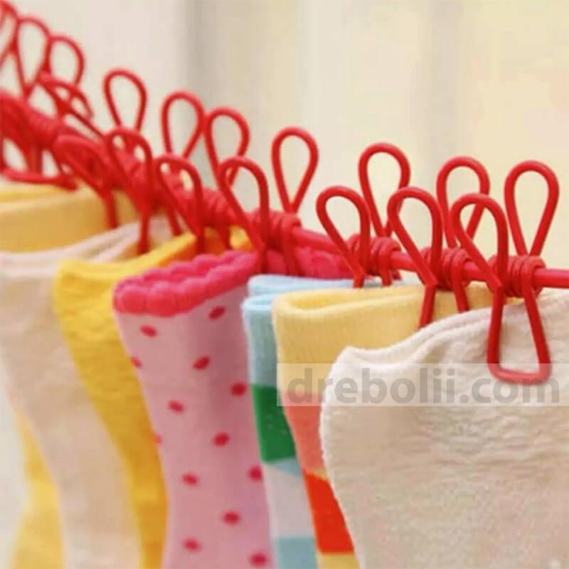 Въже за простор с щипки